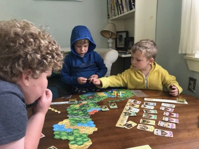 the boys playing a board game