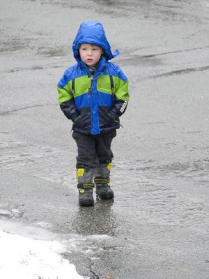 Lijah walking in the rain