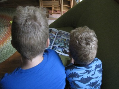 Harvey and Lijah reading, seen from behind