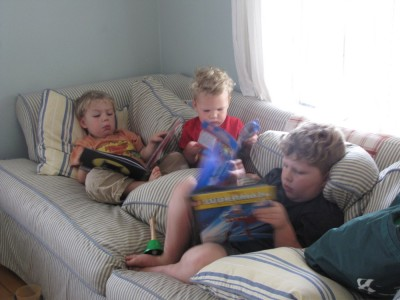 three boys on the couch with three books
