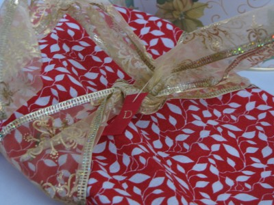 a cloth-wrapped, gold-ribboned present