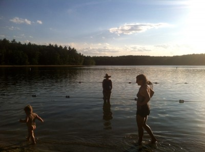 naked lijah walking with Mama in the shallow water at Walden