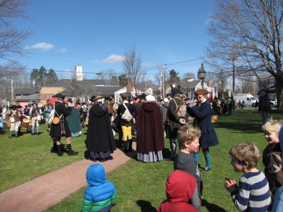 the kids looking at lots of reenactors on the common