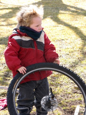 Harvey posing with a rear wheel