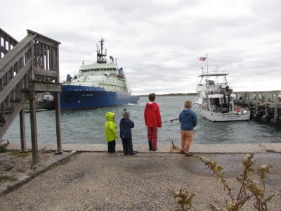 Zion, Harvey, Matthew and Sam looking at the research ships in the harbor at Woods Hole