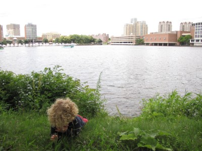 Harvey lying down and crying beside the Charles River