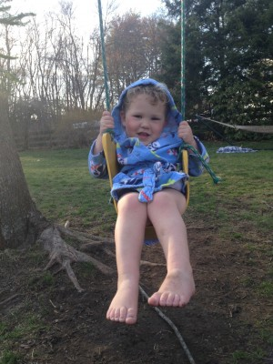 Lijah on the swing in our yard in his bathrobe