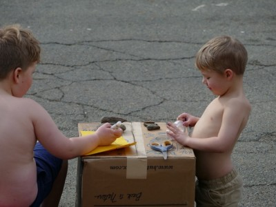 shirtless Harvey and Zion selling rocks at the side of the street