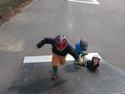 the boys playing on a ramp in the skate park