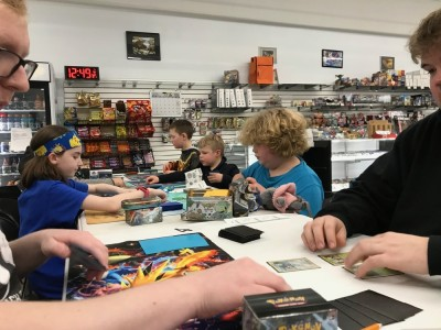 Zion and Harvey playing Pokemon at a prerelease event