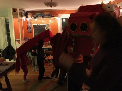 a homemade chinese new year dragon parading in our playroom
