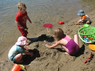 the kids working on their sand structure, a raised pool