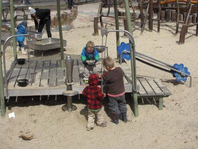 the three boys working at the sand factory