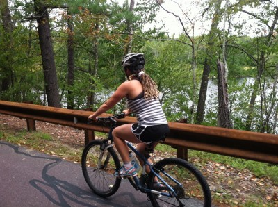 Leah riding her mountain bike by Flint Pond