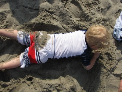 zion lying on his stomach in the sand