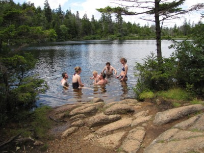 the expedition cooling off in Sargent Pond