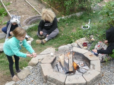 kids toasting marshmallows and mashing acorns in our backyard