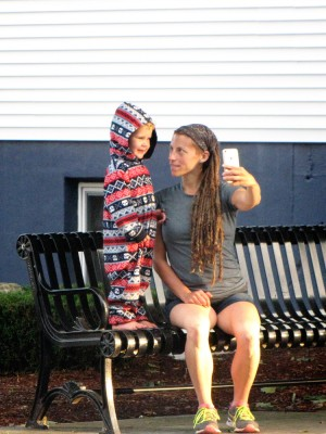 Leah and Lijah taking a selfie on a roadside bench