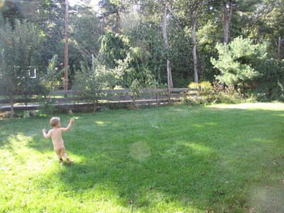 Lijah running in the sprinkler naked