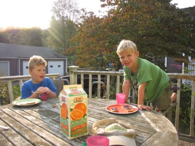 Harvey and Zion eating breakfast on the back porch