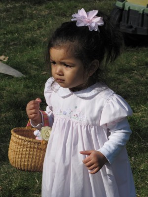 Kamilah looking serious holding her basket