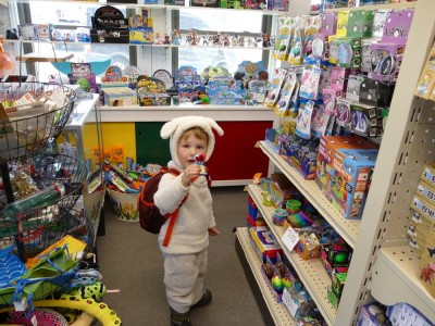 Lijah (in sheep costume) browsing in a toy store