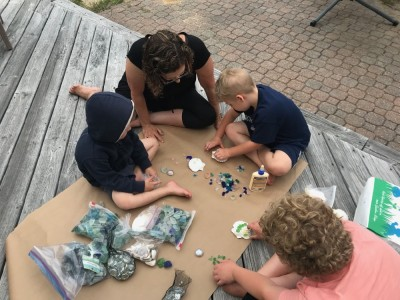 the boys gluing shells and sea glass with Grandma
