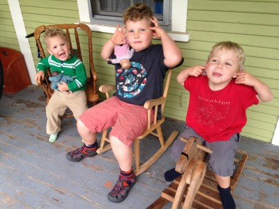 the boys sitting on the front porch making faces