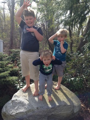 the boys standing on a rock striking a silly pose