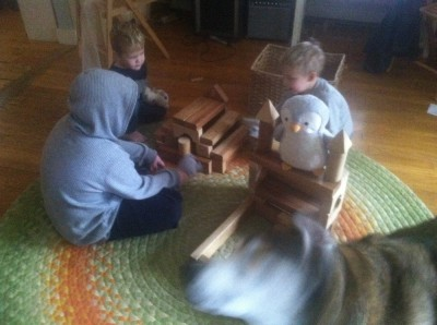 the boys playing with blocks and stuffed animals