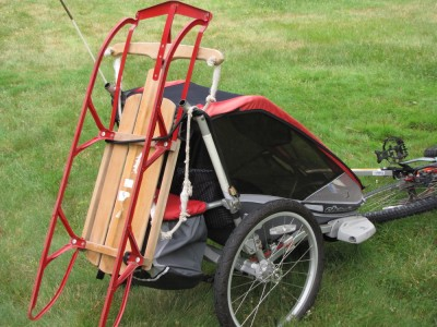 a sled on the back of the bike trailer