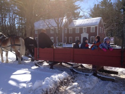 Leah and the boys with friends on a horse-drawn sleigh at Sturbridge