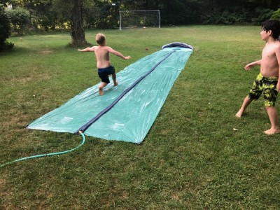 Zion on a friends' slip-n-slide