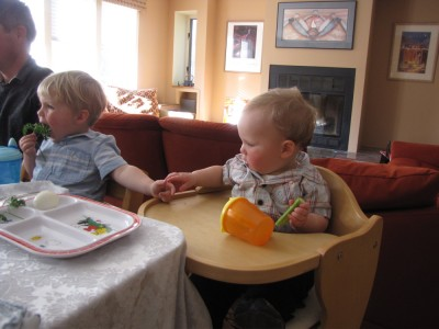 Zion and Lijah (momentarily) holding hands at the table