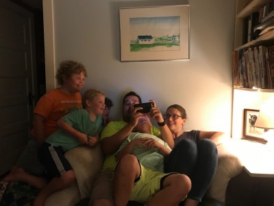 the kids watching a video on Samuel's phone at small group