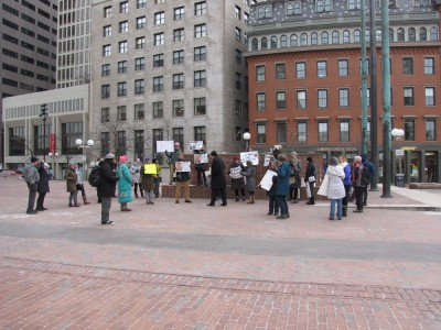 a small crowd protesting on City Hall Plaza