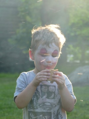 Lijah eating a smore in smoke and sparks