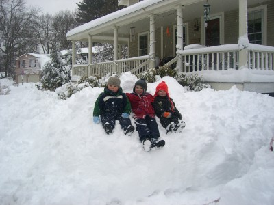 the neighborhood boys on a snowbank