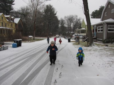 kids running to the bus stop in the snow
