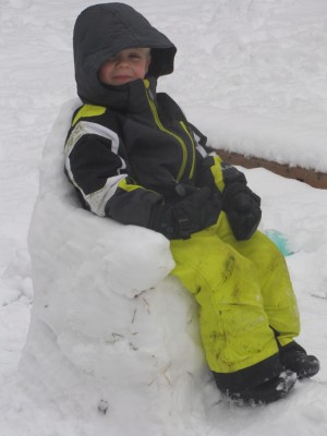 zion sitting in a snow chair