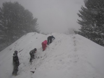 Harvey and friends climbing up a giant snow-covered pile of dirt