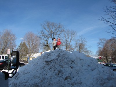 Harvey and Zion atop a giant mound of snow
