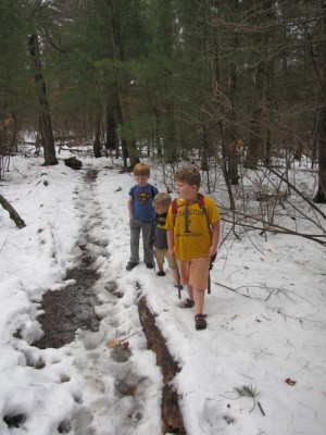 Harvey, Zion, and Nathan hiking in the snow--Harvey and Zion in shorts and sandals