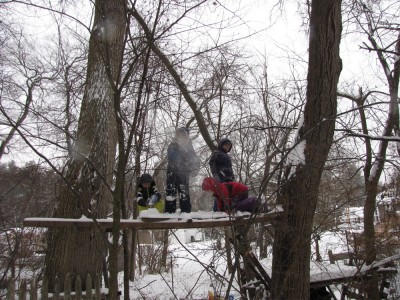 kids in a tree-platform throwing snow