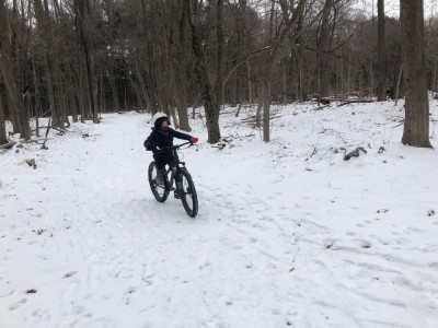 Zion riding his bike on snowy doubletrack