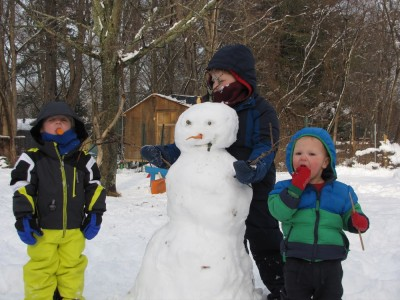 the boys posing with their snowman