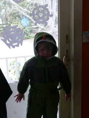Zion in his snowsuit by the side door