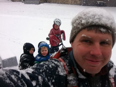 the boys and I snow-covered on bikes