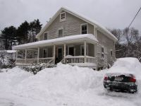 our house with even more snow than last time