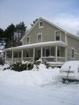 our house under the first real snow of winter 2010-2011